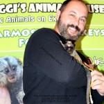 Guy with baby Marmoset Monkey