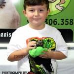 Little boy holding a Baby Marmoset Monkey