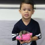 Little boy holding baby Marmoset Monkey