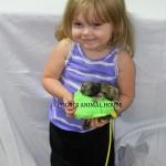 Young girl with Baby Marmoset Monkey