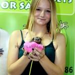 Girl holding Marmoset Monkey