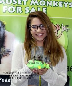 Girl with glasses holding Marmoset Monkey
