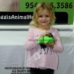 Little girl holding baby Marmoset