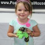 Little girl with baby marmoset monkey
