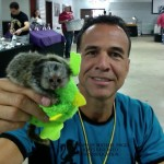 Michael Poggi holding baby Marmoset